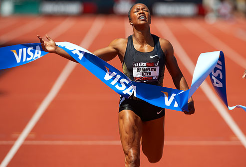 getty_rm_photo_of_carmelita_jeter_crossing_finish_line